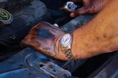 Auto Mechanic`s Greasy Hands royalty free stock image