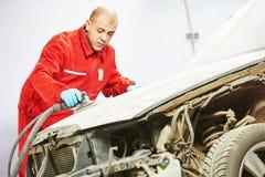 Auto mechanic sanding and polishing car Stock Photography