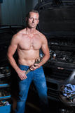 Auto mechanic. At service station with naked upper body royalty free stock photos