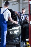 Auto mechanic servicing a car Stock Photography