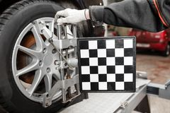 Auto mechanic sets the car for diagnostics and configuration. Wheel alignment equipment on a car wheel in a repair. Station stock photos