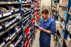 Auto mechanic or smith with tablet pc at workshop Stock Image