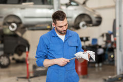Auto mechanic or smith with wrench at car workshop Royalty Free Stock Photography
