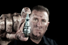 Auto mechanic and sparkplug Royalty Free Stock Photo