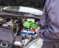 Auto mechanic testing the electrical system on automobile Stock Photo