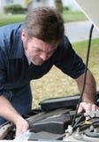 Auto Mechanic Under The Hood Stock Images