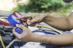 Auto mechanic uses a pressure gauge on the air compressor,liquid. Air pressure,compressor,manometer in a car,Selective focus Stock Photo