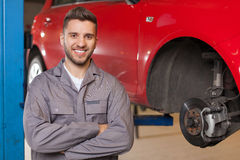 Auto Mechanic Waiting with Arms Crossed Royalty Free Stock Images