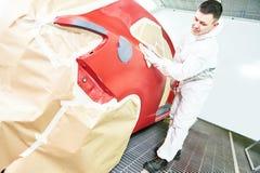 Auto mechanic wiping car Stock Photography