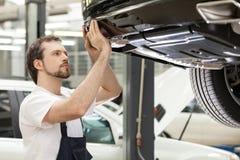 Auto mechanic at work. Royalty Free Stock Photo