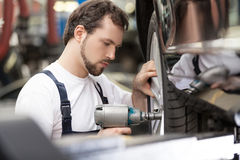 Auto mechanic at work shop. Stock Photo