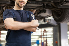 Auto mechanic with work tool. Stock Images