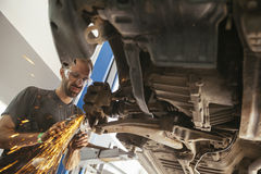 Auto Mechanic At Work Stock Photos