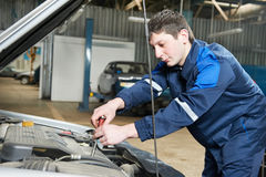 Auto mechanic at work with wrench Royalty Free Stock Images
