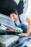 Auto mechanic working in car service Royalty Free Stock Photos