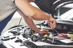 Auto mechanic working in garage. Repair service royalty free stock photos
