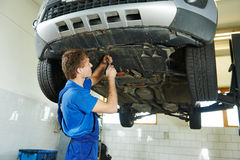 Auto mechanic working Royalty Free Stock Images