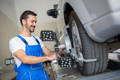 Auto mechanic  working with sensor Stock Photo