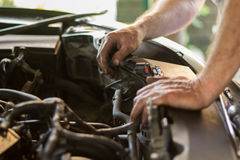Auto mechanic working. Under the hood of an old car engine stock photo