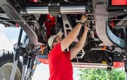 Auto mechanic working Stock Images
