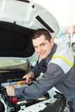 Auto mechanic with wrench. In car repair service Royalty Free Stock Photo