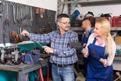Auto mechanics at workshop Royalty Free Stock Photos