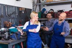 Auto mechanics at workshop Royalty Free Stock Photo
