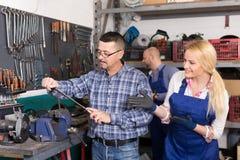 Auto mechanics at workshop Royalty Free Stock Photography