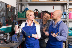 Auto mechanics at workshop Royalty Free Stock Image