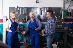 Auto mechanics at workshop Stock Photo