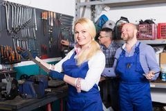 Auto mechanics at workshop Stock Image