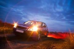 Auto na zonsondergang Stock Afbeelding