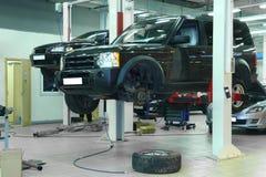 Auto onder reparatie Stock Foto's