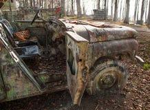 Auto op painballgebied Stock Foto's