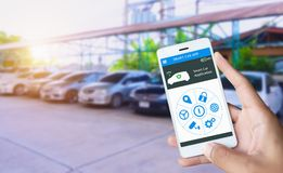 Hand holding smart phone and application dashboard with blur car stock image