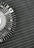 Auto parts. Used auto part atop radiator patterns, textures Stock Image