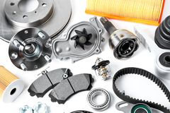 Auto parts background. Hub, pump, brake pads, filter, timing bel. T, rollers, constant velocity joints, thermostat and other on white background Stock Image