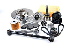 Auto parts background. Hub, pump, brake pads, filter, timing bel. T, rollers, constant velocity joints, thermostat and other on white background. Set of spare Royalty Free Stock Photo