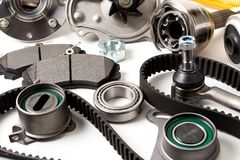Auto parts background. Hub, pump, brake pads, filter, timing belt, rollers, constant velocity joints, thermostat and other Royalty Free Stock Images