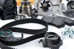 Auto parts background. Hub, pump, brake pads, filter, timing belt, rollers, constant velocity joints, thermostat and other on. White background. Set of spare stock image
