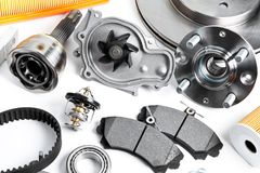 Auto parts background. Hub, pump, brake pads, filter, timing belt, rollers, constant velocity joints, thermostat and other on. White background spare new royalty free stock photography
