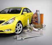 Auto parts with beautiful car. On gray background Royalty Free Stock Photo