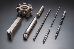Auto parts and drilling bits. Still photography on Gray background Stock Photography