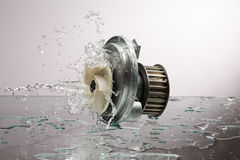 Auto parts, engine cooling pump in water splash Stock Photography