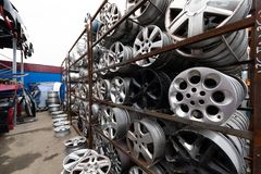 Auto parts market. Car wheels are on the ground. Everything for car repairs. Stacks of car rims stock photo