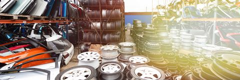 Auto parts market. Car wheels are on the ground. Everything for car repairs. Stacks of car rims royalty free stock photo