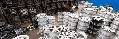 Auto parts market. Car wheels are on the ground. Everything for car repairs. Stacks of car rims royalty free stock photography