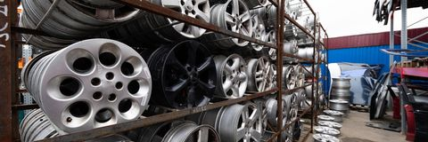 Auto parts market. Car wheels are on the ground. Everything for car repairs. Stacks of car rims stock images