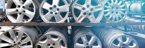 Auto parts market. Car wheels are on the ground. Everything for car repairs. Stacks of car rims stock photos