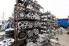 Auto parts market. Car wheels are on the ground. Everything for car repairs. Stacks of car rims royalty free stock image